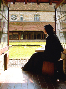 Nun reading in the Cloister